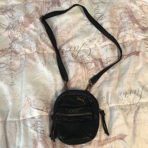A small puma miniature backpack/ side purse